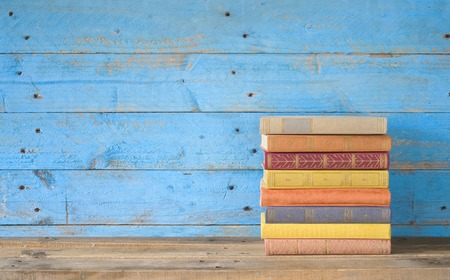 colorful books on a wooden shelf, free copy space
