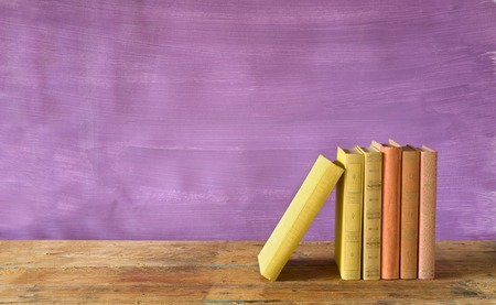 book background: row of books, grungy background, free copy space  Stock Photo