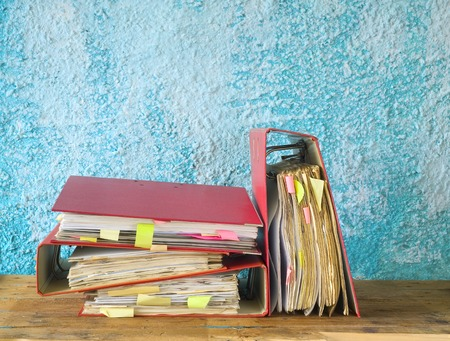 disorganization: file folders with messy documents, free copy space