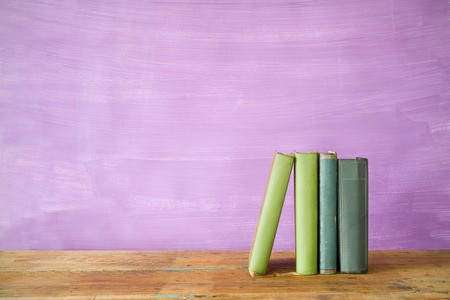 book spine: row of books, grungy background, free copy space  Stock Photo