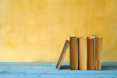 row of books, grungy background, free copy space  Standard-Bild