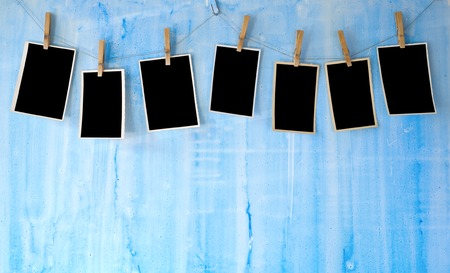 photo frames on blue wall Stock Photo