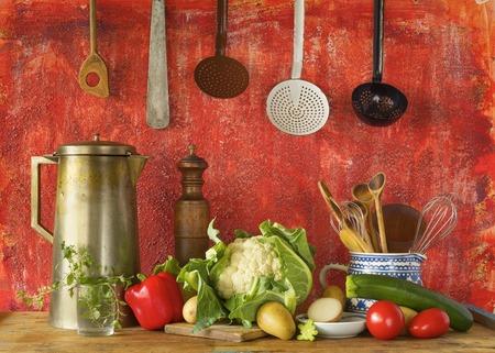 retro kitchen: retro kitchen utensils and vegetables, cooking concept Stock Photo