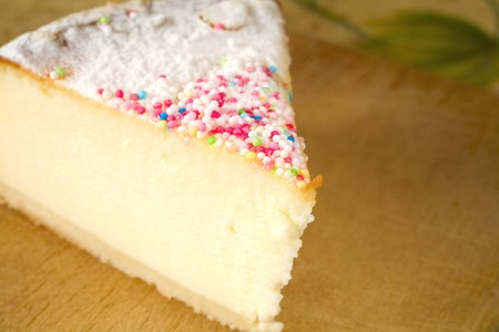 hundreds and thousands: slice of cheese cake with hundreds and thousands decoration Stock Photo