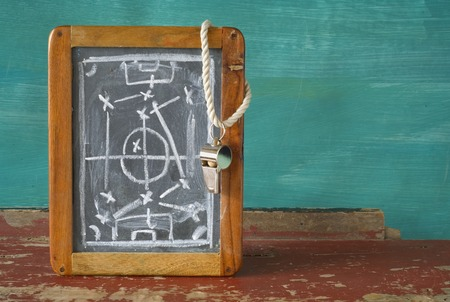 tactic: whistle of a soccer  football referee and tactics blackboard, free copy space Stock Photo
