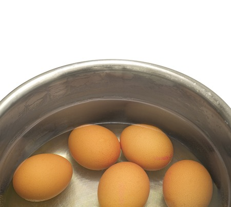 evaporate: hen eggs  in metal pot  isolated on white background