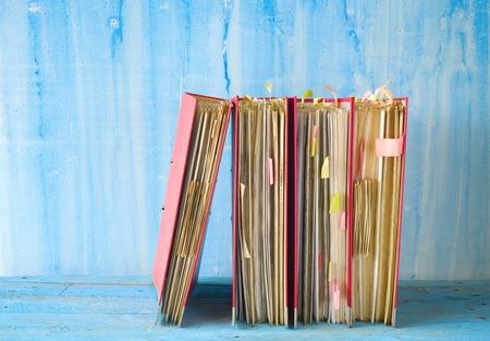 disorganization: row of messy file folders, free copy space
