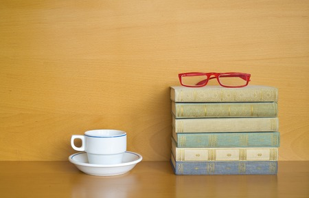 stack of books, cup of coffee, glasses, free copy space