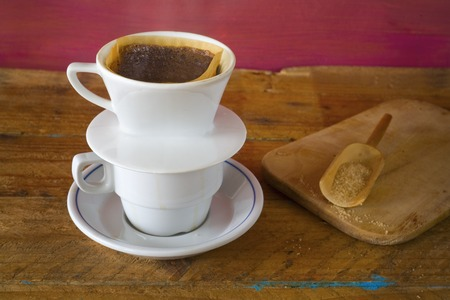coffee filter: fresh brewed coffee and a coffee filter