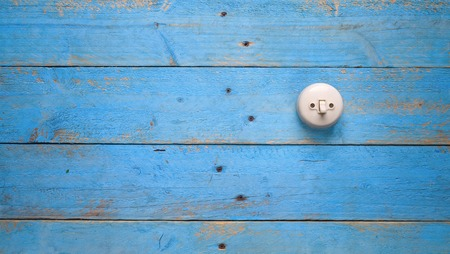 light switch: light switch on blue wood wall, free copy space