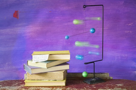 cogitation: stack of book and a mobile, motion blur, thinking concept