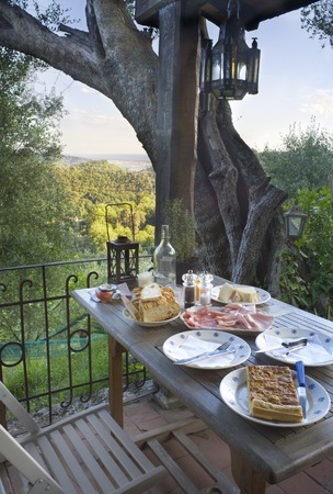 eating area: dinner on a terrace in the Mediterranean area with italian food