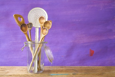 every: Kitchen utensils in a glass jar free copy space Stock Photo