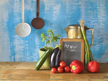 vintage kitchen: Various vegetables, menu black board, kitchen utensils,free copy space