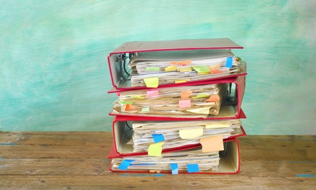 tabulate: messy file folders on grungy background, free copy space Stock Photo