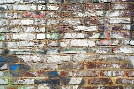 sprayed: grungy brick wall background w. sprayed paint, free copy space Stock Photo
