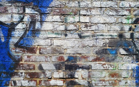 sprayed: grungy brick wall background w. sprayed paint, free copy space Stock Photo
