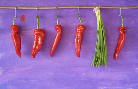 green onions: hanging bell pepper and green onions,free copy space
