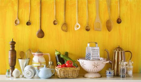 yellow tea pot: various old kitchen utensils and vegetables, cooking concept Stock Photo