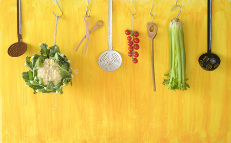 utensils: vegetables and kitchen utensils, free copy space Stock Photo