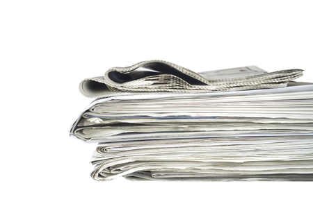newspaper print: newspaper stack, isolated on white background, free copy space
