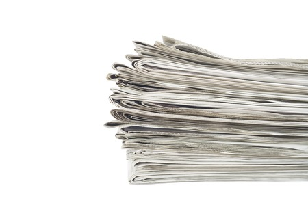gazette: stack of newspapers, close up, isolated on white back,free copy space