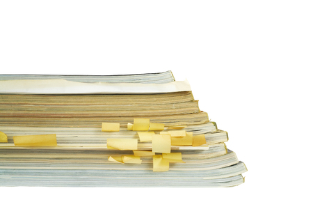 gazette: stack of old magazines, close up, isolated on white back,free copy space