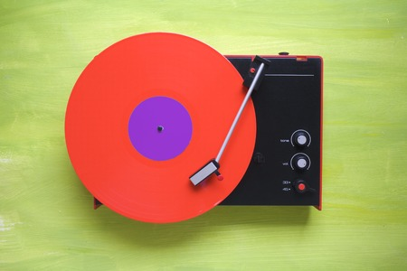 analogous: hipsters retro turntable with red vinyl record,