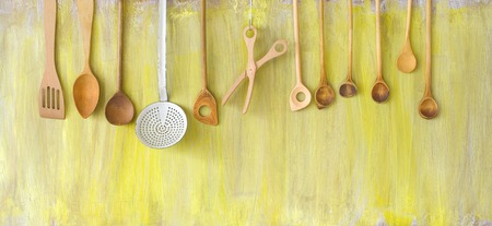 skimmer: old wooden kitchen tools and an old enamel skimmer, cooking concept
