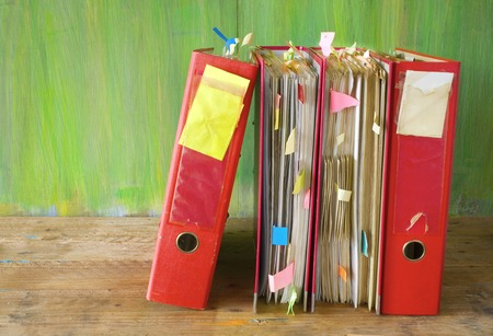 tabulate: row of file folders with messy documents