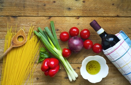 utensils: food ingredients for italian spaghetti, bottle of wine, free copy space Stock Photo