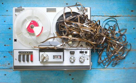 tape recorder: vintage reel to reel tape recorder with jammed audio tape