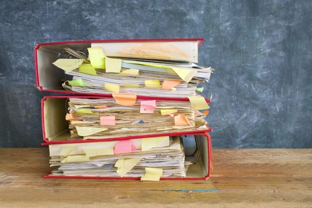 dossier: stack of messy file folders and documents,free copy space Stock Photo