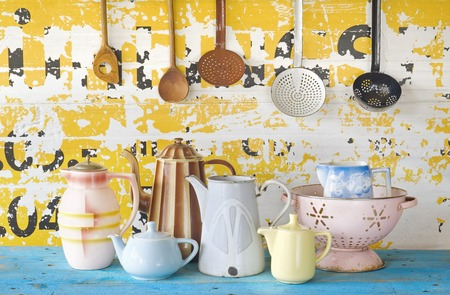 kitchen tool: various vintage tableware and kitchen utensils on grungy background