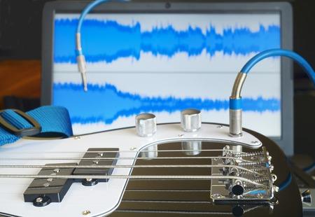 bass guitar: bass guitar and a laptop,  home recording concept