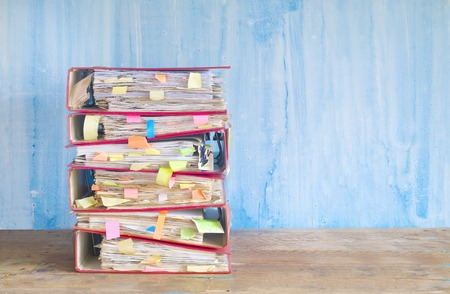 file folders: stack of messy file folders and documents,free copy space Stock Photo