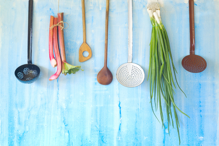 green onions and rhubarb fresh from the garden, plus vintage kitchen utensils Stock Photo