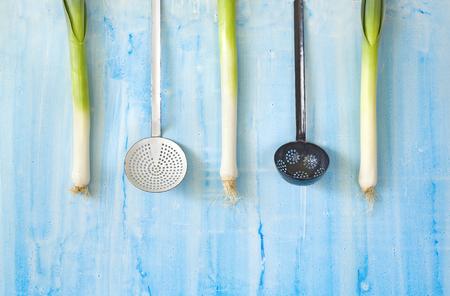 garden leek  and vintage enamel kitchenutensils Stock Photo