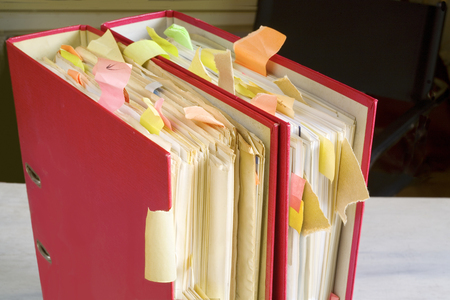 tabulate: messy file folders, close up, selective focus, good copy space