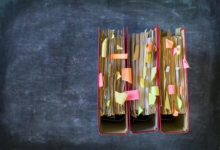 tabulate: Messy file folders, flat lay, good copy space Stock Photo