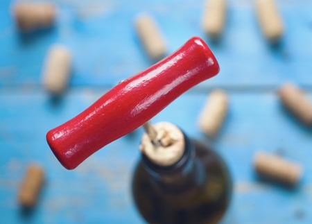 cork screw: cork screw,corks,wine bottle, close up,selective focus