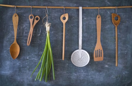 green onions: vintage kitchen utensils and green onions, cooking concept