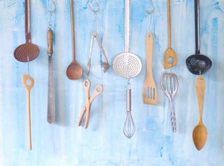 kitchen utensils: various vintage kitchen utensils, on grungy wall Stock Photo