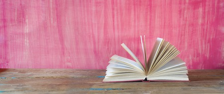 red book: open book on red grungy background, good copy space Stock Photo