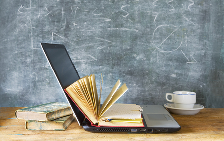 educational research: open book and laptop, learning, education, e-book concept Stock Photo
