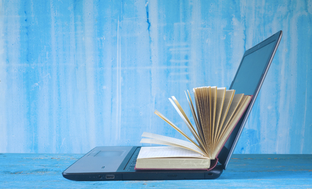 open book and laptop, learning, education, e book concept Stock Photo