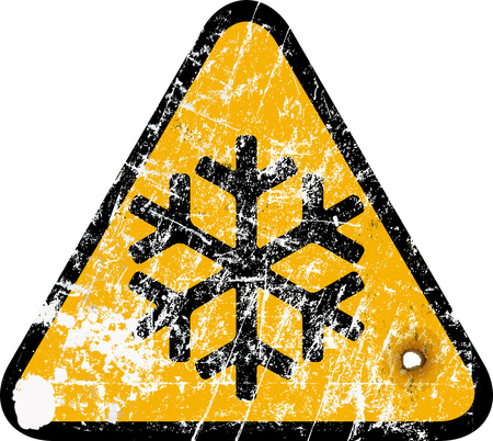 snowstorm: ice warning traffic sign, weathered
