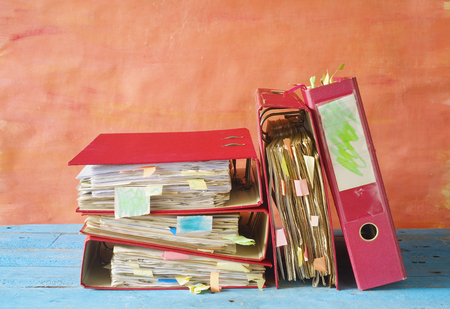 tabulate: messy file folders, red tape concept