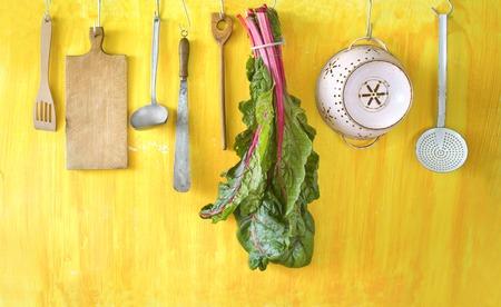 beta: vintage kitchen utensils and mangel, silverbeet, Swiss chard, Beta vulgaris Stock Photo