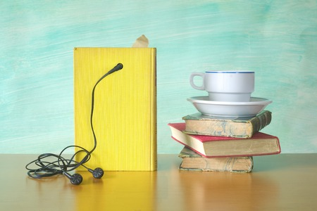 audio book: audio book and a cup of coffee, modern reading concept